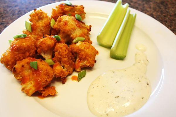 Buffalo Cauliflower ready to serve with celery and ranch dressing