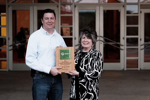 Bryan Moore and Sherrian Jones pose with the U.S. Composting Council Award.